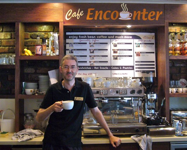 Chris F Carroll in 2012, with Cafe Encounter's Brazilia 2-Group Espresso Machine
